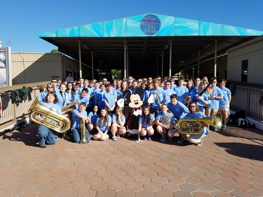 The whole band in front of the Disney Performing Arts with Mickey.