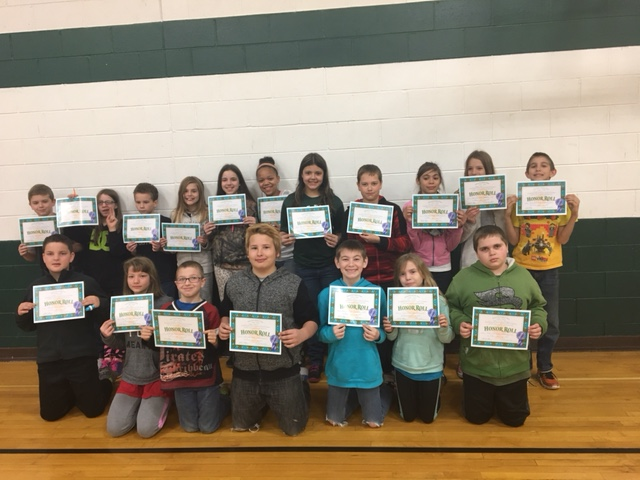 Group of students holding their awards.