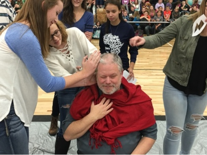 Students cutting Mr. Rupperts hair