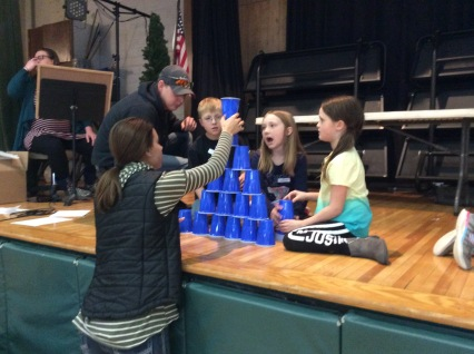 Kids stacking cups in a game